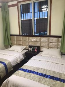 A bed or beds in a room at Youranju Guesthouse