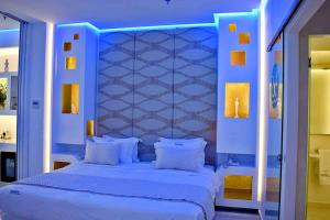 A bed or beds in a room at Aegialis Hotel & Spa
