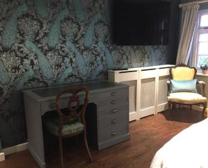 A television and/or entertainment center at Heydon Guest Suite
