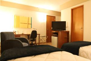 A television and/or entertainment center at Travel Inn Live & Lodge Ibirapuera Flat Hotel