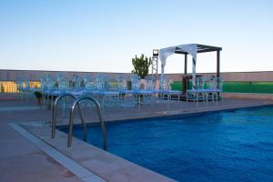 The swimming pool at or near Royal Macaé Palace Hotel