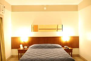 A bed or beds in a room at Travel Inn Live & Lodge Ibirapuera Flat Hotel