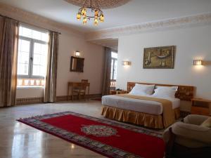 Кровать или кровати в номере Dar Nador