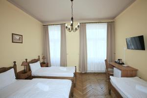 Ein Bett oder Betten in einem Zimmer der Unterkunft Merlin