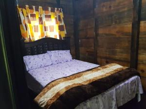 A bed or beds in a room at Cabañas Cinco Lagos