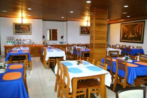 A restaurant or other place to eat at Swamy Hotel