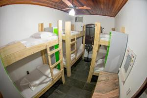 A bunk bed or bunk beds in a room at Social Ilha Grande Hostel