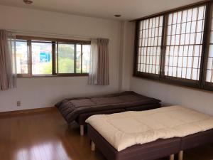 Guesthouse LARGOにあるベッド