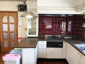 Guesthouse LARGOにあるキッチンまたは簡易キッチン