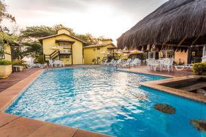 A piscina localizada em Pousada Pontal da Praia ou nos arredores