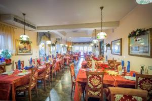 A restaurant or other place to eat at Locanda Fabrizio