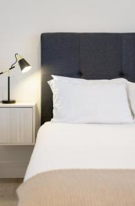 A bed or beds in a room at EIGHT TWO NINE TWO III: BONDI BEACH