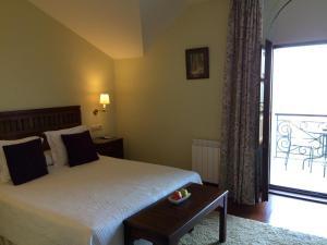 A bed or beds in a room at Quinta de Villanueva