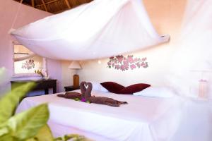 A bed or beds in a room at Cabañas El Cielito