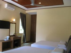 A bed or beds in a room at New Dawn for Langkawi