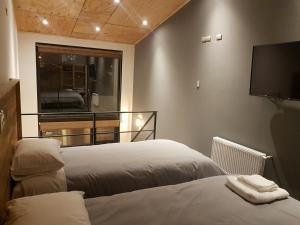 A bed or beds in a room at EcoLofts Croacia 1028