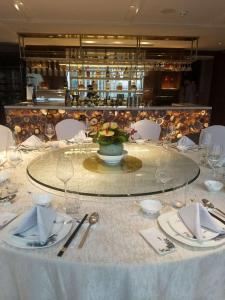 مطعم أو مكان آخر لتناول الطعام في Howard Johnson Huaihai Hotel