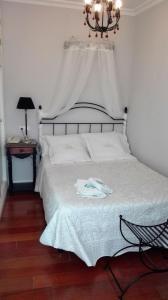 Cama o camas de una habitación en Le Petit Paris