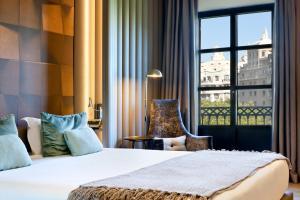 Cama o camas de una habitación en Condes de Barcelona