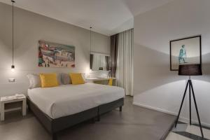 A bed or beds in a room at Navona Theatre Hotel