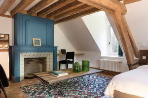A seating area at Le Manoir de la Plage / Adults Only