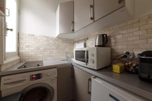 A kitchen or kitchenette at Private Studio - Avenue des Champs-Elysées