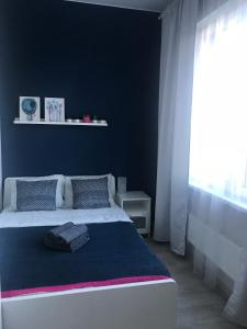 A bed or beds in a room at Magic station Odintsovo I