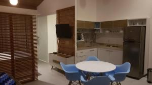 A kitchen or kitchenette at Flat Solar Água Pipa Prime