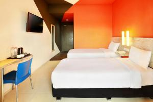 A bed or beds in a room at ibis Budget Bali Seminyak