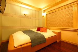 A bed or beds in a room at Hotel Smile (Adult Only)