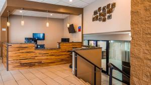 A television and/or entertainment center at SureStay Plus Hotel by Best Western Gatlinburg