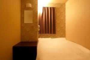 A bed or beds in a room at Hotel Peace (Adult Only)