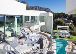 The swimming pool at or near Hollywood Mansion & Spa Camps Bay