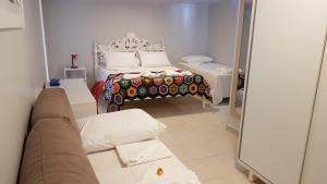 Cama ou camas em um quarto em Pousada das Bromélias