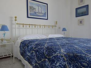 A bed or beds in a room at Villa Aprilia with THERMAL SPA POOL