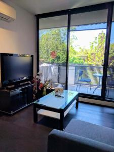 A television and/or entertainment center at Camberwell Burke Road Apartment