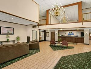 The lobby or reception area at Days Inn by Wyndham Madisonville