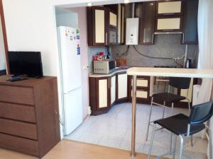 Кухня или мини-кухня в Apartment on Sovetskaya 9