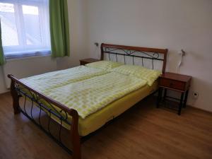 A bed or beds in a room at Moskevská 40