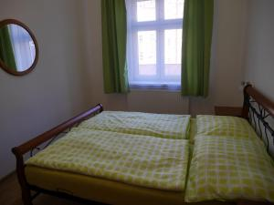A bed or beds in a room at Moskevská 40