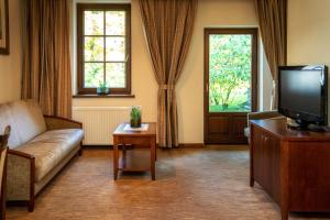 Telewizja i/lub zestaw kina domowego w obiekcie Hotel Murowanica
