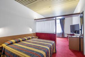 Letto o letti in una camera di Hotel Plaza