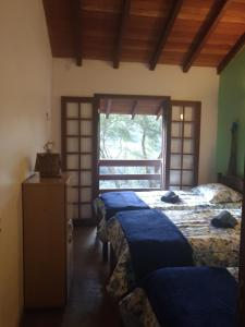 A bed or beds in a room at Casa Do Valle