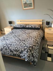 A bed or beds in a room at Ballantrae B&B
