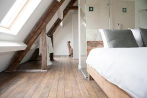 Een bed of bedden in een kamer bij Gasterij Landschot