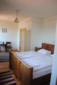 Łóżko lub łóżka w pokoju w obiekcie Karczma Stary Młyn