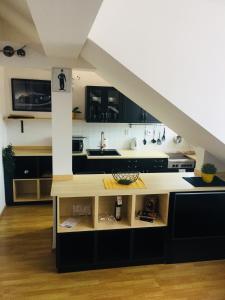 A kitchen or kitchenette at Pension Hattrick