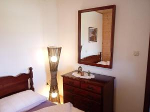 Postel nebo postele na pokoji v ubytování Villa Sandra