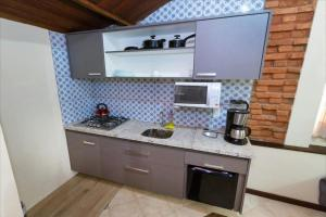 A kitchen or kitchenette at Solar do Carmo Suites & Apartments