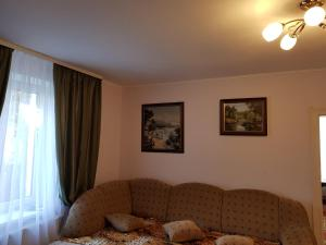 A seating area at Семейные Апартаменты